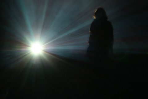 Photo of a person silhouetted by bright sunlight